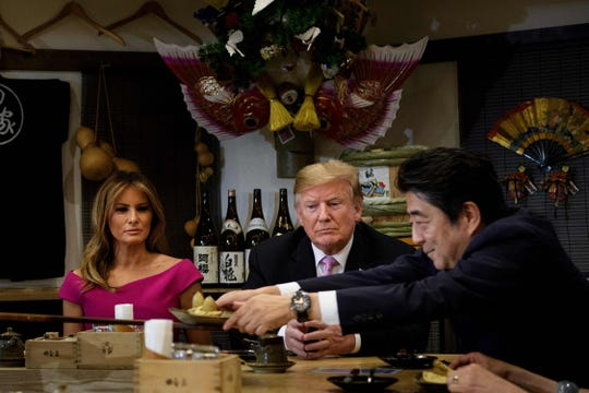 US President Donald Trump and First Lady Melania Trump join Japan's Prime Minister Shinzo Abe and his wife Akie Abe for dinner in Tokyo on May 26, 2019.