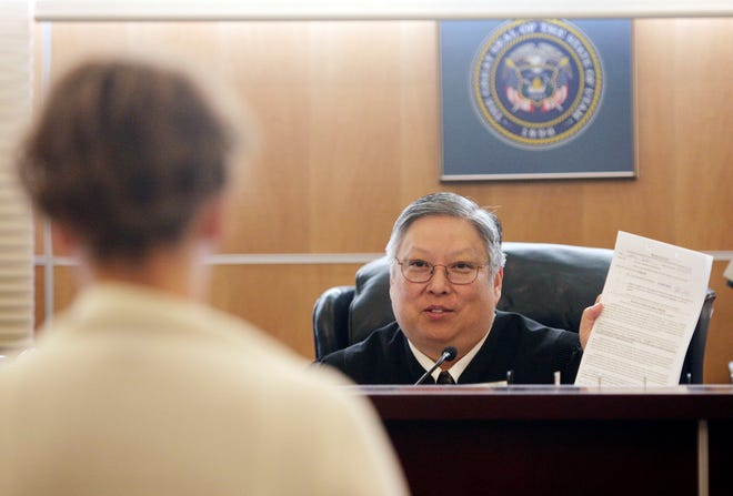 In this May 25, 2010, file photo, Judge Michael Kwan talks with a defendant during drug court in Taylorsville, Utah. Kwan, a longtime Utah judge has been suspended without pay for six months for comments he made online and in court criticizing President Donald Trump that the state's supreme court determined violated the judicial code of conduct.