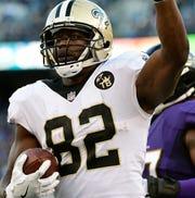 Ben Watson reacts after catching Saints quarterback Drew Brees' 500th career touchdown pass.