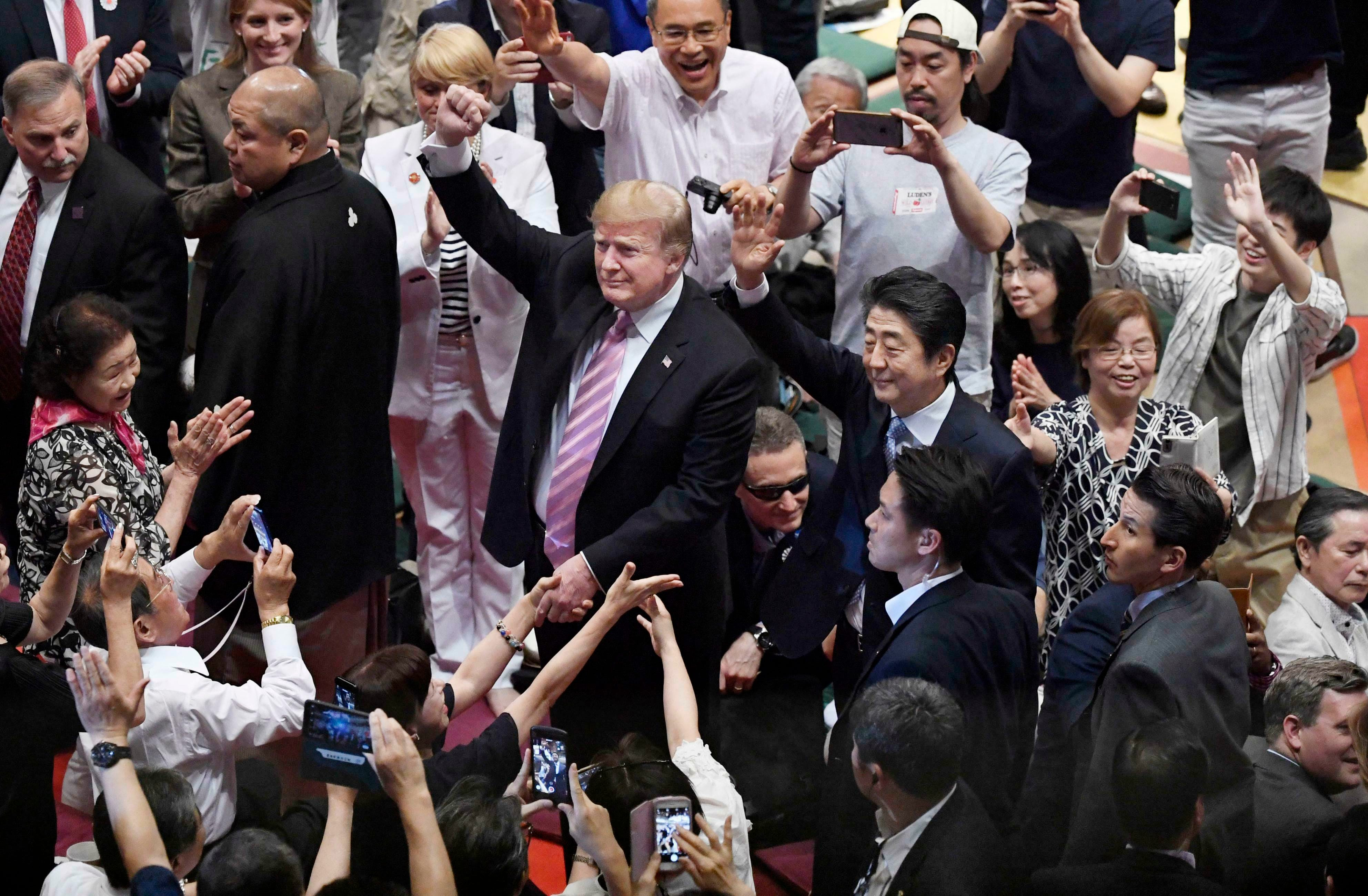 President Trump gives massive trophy to sumo champion in Tokyo, Japan