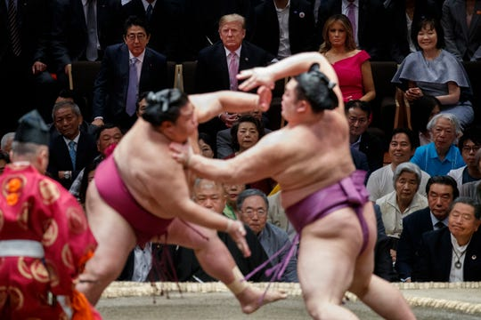 President Donald Trump attends the Tokyo Grand Sumo Tournament with Japanese Prime Minister Shinzo Abe at Ryogoku Kokugikan Stadium, Sunday, May 26, 2019, in Tokyo. At top right is Akie Abe and second from right is first lady Melania Trump.