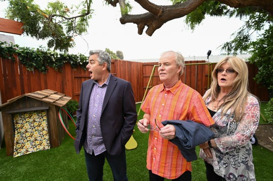 'Brady Bunch' stars Christopher Knight, left, Mike Lookinland and Susan Olsen take in the re-created backyard of the Los Angeles home that served as the exterior for the ABC family sitcom, which ran from 1969 to 1974. HGTV has rebuilt and redesigned the interior to mirror the show's iconic sets.