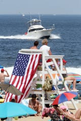 A boat cruises down the Belmar, NJ, coastline on Memorial Day Monday, May 27, 2019.