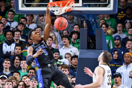 Jan 28, 2019; South Bend, IN, USA; Duke Blue Devils forward R.J. Barrett (5) dunks in front of Notre Dame Fighting Irish forward John Mooney (33) in the second half at the Purcell Pavilion. Mandatory Credit: Matt Cashore-USA TODAY Sports