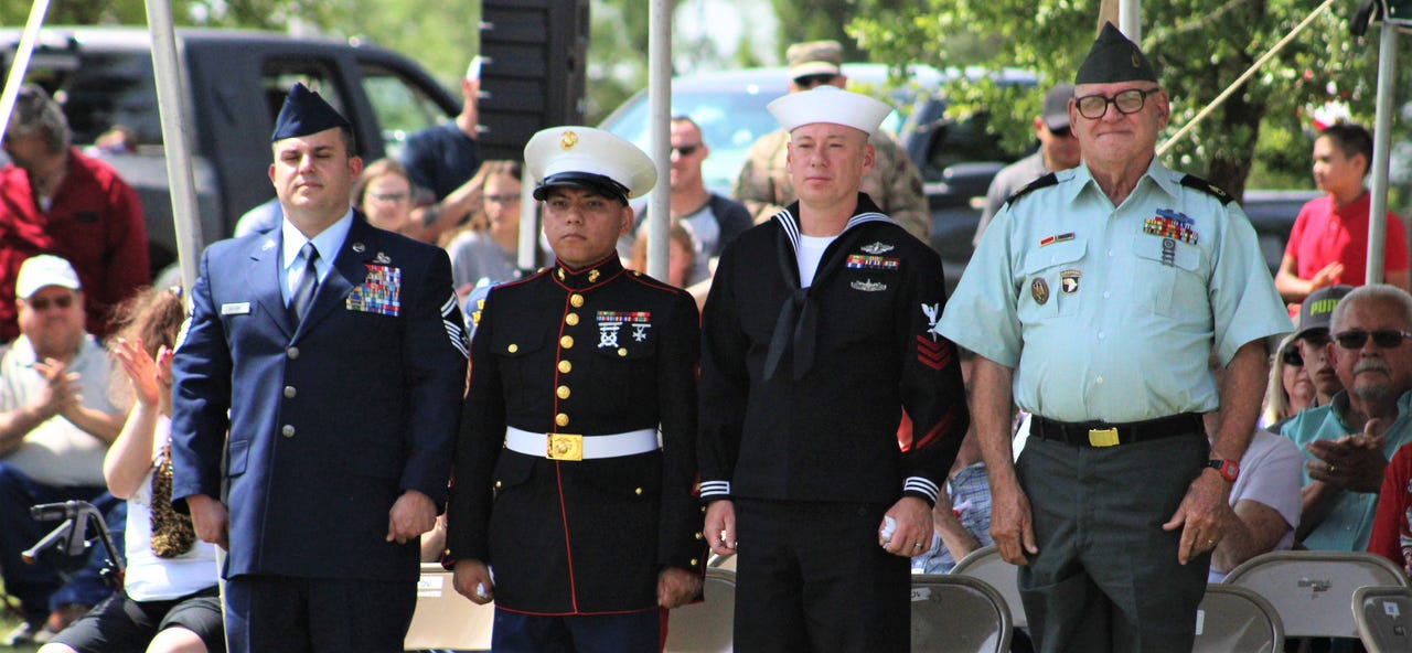 The Air Force (from left), Marine Corps, Navy and Army were represented by the uniforms of four attendees at Monday's Memorial Day ceremony at Texas State Veterans Cemetery at Abilene. The four were asked to stand, to applause from large crowd.