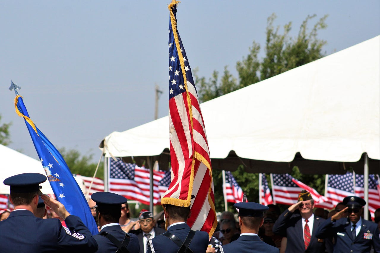 Salutes to the U.S. flag were given when the colors were presented Monday at a Memorial Day ceremony at Texas State Veterans Cemetery at Abilene. May 27 2019