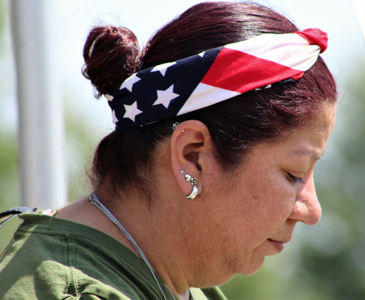 Celestina Garcia showed her patriotism by wearing a flag bandanna to Monday's Memorial Day ceremony at Texas State Veterans Cemetery at Abilene. Her father, Raul Garcia, served in the Air Force and was interred at the cemetery in 2017, she said. May 27, 2019