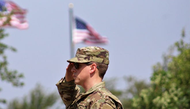 Staff Sgt. Tyler Quilty, who is stationed at Dyess Air Force Base, salutes during Monday's Memorial Day ceremony at Texas State Veterans Cemetery at Abilene. May 27, 2019