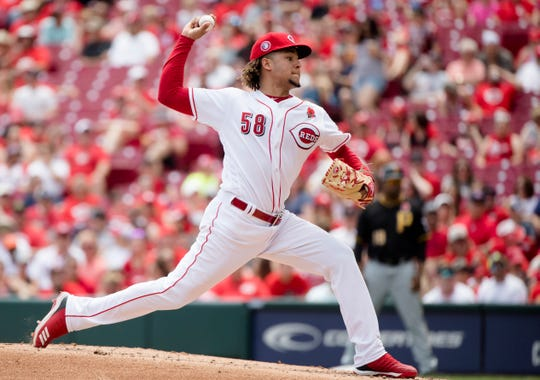 Cincinnati Reds starting pitcher Luis Castillo (58) throws a pitch in the third inning of the MLB National League game between Cincinnati Reds and Pittsburgh Pirates at Great American Ball Park in Cincinnati on Monday, May 27, 2019.