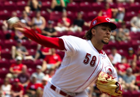 Cincinnati Reds starting pitcher Luis Castillo (58) pitches in the sixth inning of the MLB National League game between Cincinnati Reds and Pittsburgh Pirates at Great American Ball Park in Cincinnati on Monday, May 27, 2019.