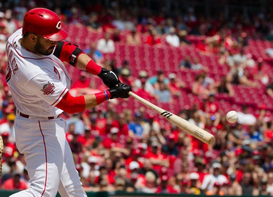 Cincinnati Reds third baseman Eugenio Suarez (7) hits an RBI double in the fifth inning of the MLB National League game between Cincinnati Reds and Pittsburgh Pirates at Great American Ball Park in Cincinnati on Monday, May 27, 2019.