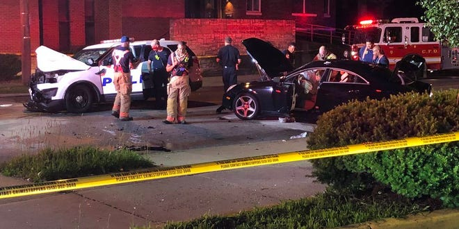 Three people including a Cincinnati police officer were taken to the hospital following an early morning crash Monday.