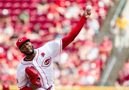 Cincinnati Reds relief pitcher Amir Garrett (50) throws a pitch in the sixth inning of the MLB National League game between Cincinnati Reds and Pittsburgh Pirates at Great American Ball Park in Cincinnati on Monday, May 27, 2019.