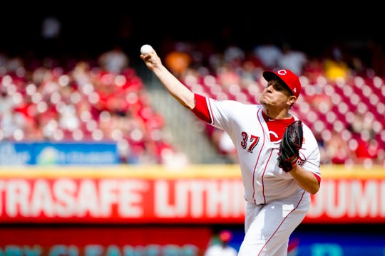 Cincinnati Reds relief pitcher David Hernandez (37) throws a pitch in the eighth inning of the MLB National League game between Cincinnati Reds and Pittsburgh Pirates at Great American Ball Park in Cincinnati on Monday, May 27, 2019.