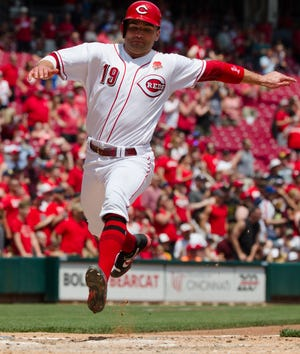 Cincinnati Reds first baseman Joey Votto (19) scores a run on a RBI double in the fifth inning of the MLB National League game between Cincinnati Reds and Pittsburgh Pirates at Great American Ball Park in Cincinnati on Monday, May 27, 2019.