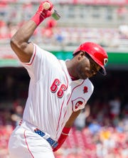 Cincinnati Reds right fielder Yasiel Puig (66) throws his bat  in the fourth inning of the MLB National League game between Cincinnati Reds and Pittsburgh Pirates at Great American Ball Park in Cincinnati on Monday, May 27, 2019.