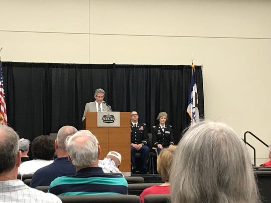 Patrick Palmersheim, coordinator of Wreaths Across America, speaks at Monday's Iowa Events Center Memorial Day program.