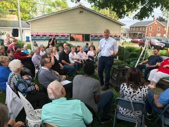 Sen. Cory Booker speaks to Iowans gathered in a back yard in Muscatine on Saturday, May 25, 1019.