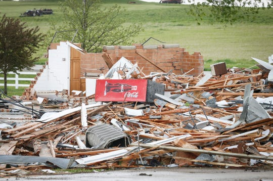 A Coca-Cola soda machine sits on a pile of rubble at the Floyd County Fairgrounds in Charles City after a tornado touched down on the area on Monday, May 27, 2019.