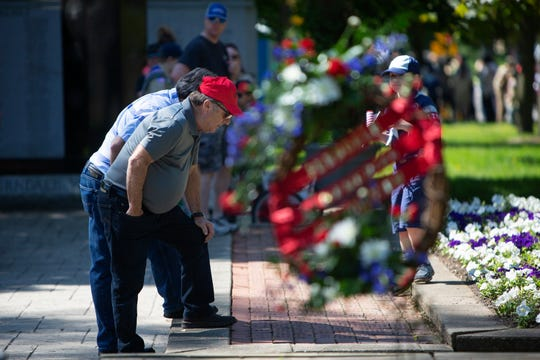 Vietnam veteran Gille Arsenault, 71, who grew up in Ferndale and now lives in Coldwater looks at commemorative bricks at the Ferndale Memorial Mall in Ferndale, Mich., Sunday, May 27, 2019.