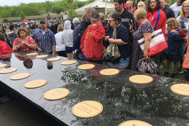 The Fallen Comrade Table, a memorial to 22 Michigan Marines killed in Iraq in 2006-07, was dedicated in Chesterfield Township on Sunday, May 26, 2019. The black granite table is decorated with 22 bronze plates for each of the Marines killed from the 1st Battalion, 24th Marines.