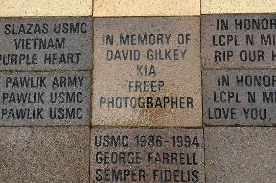 A brick honoring former Free Press photographer David Gilkey, killed in June 2016 while on assignment in Afghanistan for NPR, when the armored vehicles he was traveling in came under attack. The Fallen Comrade Table, a memorial to 22 Michigan Marines killed in Iraq in 2006-07, was dedicated in Chesterfield Township on Sunday, May 26, 2019.