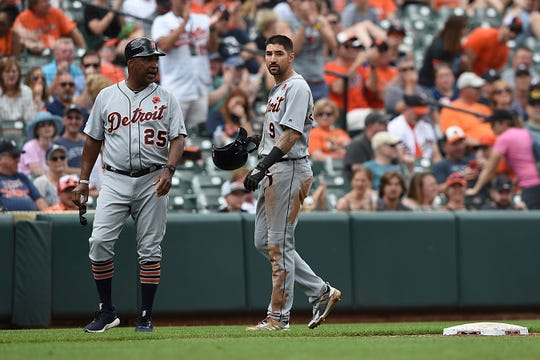 Tigers right fielder Nicholas Castellanos, right, walks off the field past third base coach Dave Clark after getting picked off by the Orioles in the fifth inning on Monday, May 27, 2019, in Baltimore.