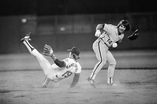 Pete Rose of the Philadelphia Phillies staggers after crashing into New York Mets shortstop Ron Gardenhire on the base path at Shea Stadium, Sept. 17, 1981, New York