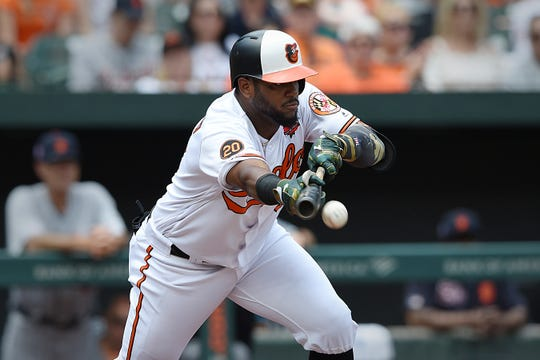 Orioles third baseman Hanser Alberto bunts for a base hit against the Tigers in the first inning on Monday, May 27, 2019, in Baltimore.