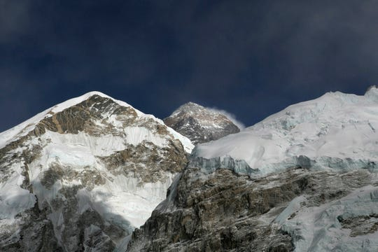 In this March 7, 2016, file photo, Mt. Everest, in middle, altitude 8,848 meters (29,028 feet), is seen on the way to base camp.