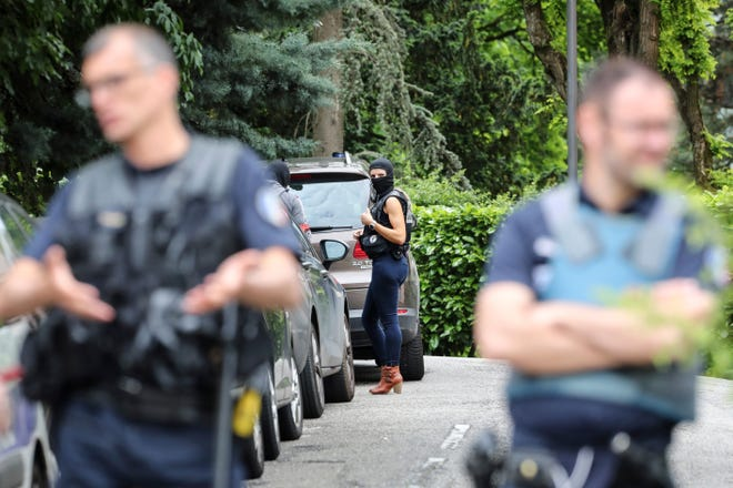 French police officers search at a suspect's home following a blast in Lyon, Monday May 27, 2019 in Oullins, central France. French police have arrested four suspects.