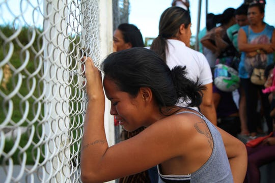 A relative of a prisoner cries outside the Anisio Jobim Prison Complex in Manaus, Amazonas state, Brazil, Monday, May 27, 2019.