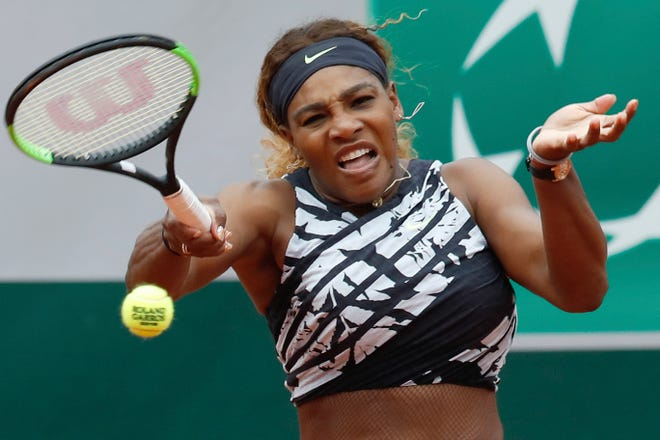 Serena Williams plays a shot against Vitalia Diatchenko during their first-round match of the French Open Monday.