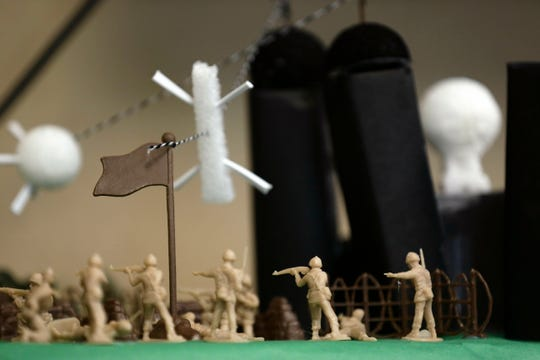 This photo taken Tuesday, May 21, 2019 shows a project created by students learning about the D-Day invasion at Normandy during a history class at Crossroads FLEX school in Cary, N.C.