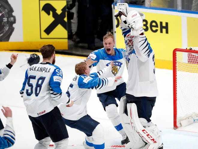 Finland goaltender Kevin Lankinen, right, celebrates with teammates after Finland beat Canada 3-1 in the Ice Hockey World Championships gold medal match.