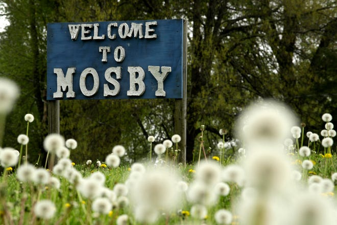 In this photo taken April 24, 2019, a sign welcomes visitors to the small community of Mosby, Mo.