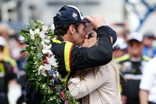 Simon Pagenaud celebrates winning the Indianapolis 500 with fiancee Hailey McDermott on Sunday.