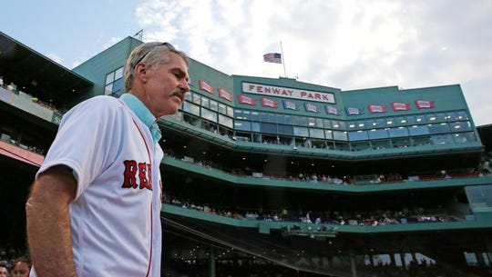 Former Boston Red Sox first baseman Bill Buckner is introduced while honored with his 1986 teammates, who won the American League championship thirty years ago, prior to the Red Sox's game against the Colorado Rockies in Boston, Wednesday, May 25, 2016.