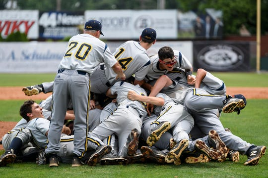 The Castle Knights celebrate their IHSAA Class 4A sectional title win at Bosse Field in Evansville, Ind., Monday, May 27, 2019. The Knights defeated the Reitz Panthers, 14-2, in five innings.