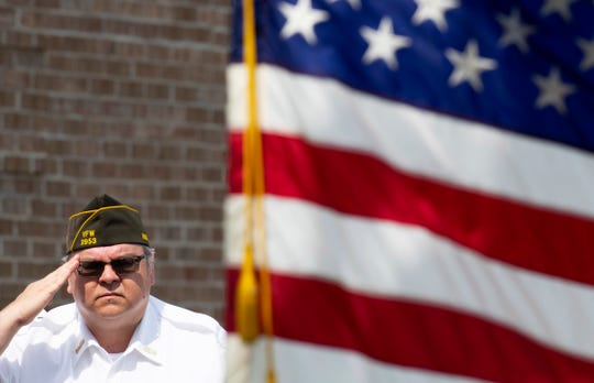 Sam Ware, quartermaster with the Veterans of Foreign Wars Post 2953 Charles Denby Post offers a salute at the start of the Memorial Day Service at the Sunset Funeral Home, Cremation Center and Cemetery Monday morning.