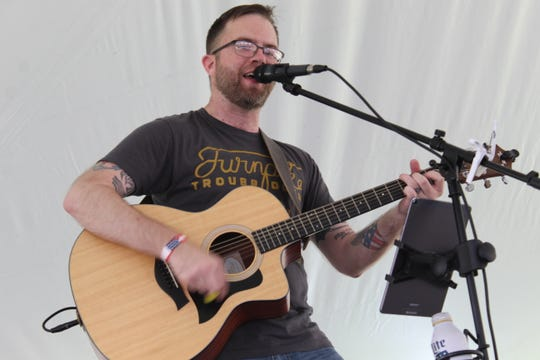 "Performer Chris Salyer sings a cover of AC/DC's ""You Shook Me All Night Long"" Monday at the Main Street Port Clinton Walleye Festival."