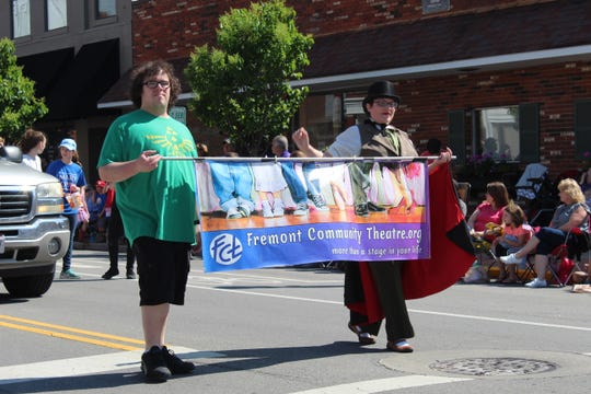 Members of the Fremont Community Theatre march in the city's annual Memorial Day parade on Front Street.