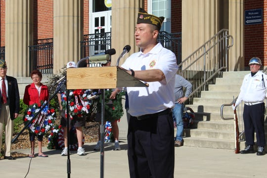 Fremont VFW Post 2947 Post Commander Terry Stanforth speaks Monday at the annual Memorial Day ceremony on the steps of the Sandusky County Courthouse.