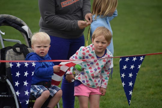 Samuel Bickley, 11/2, and sister Alexandra Bickley, 4, take in the Colorado Run on Monday at Spring Creek Park.