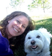 Jessica Kater and her dog Riley enjoy a day at Spring Canyon Community Park.