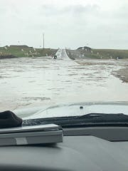 Water floods a road connecting Wheatland and Meagher counties.