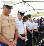 Dignitaries bow their heads during the Memorial Day Commemoration invocation at the Guam Veterans Cemetery in Piti, May 27, 2019.