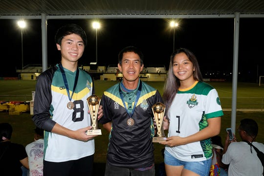 UOG Soccer Coach Rod Hidalgo, center, with Golden Boot Winners, Ryoga Okada, left, and Elisha Benavente