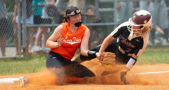 Webster County's Gracie Taylor Thomas (2) slides in safely to third base ahead of the tag from Hopkinsville's Taylor Joachim in the Region 2 Tournament at the Clarky Clark Athletic Complex in Dixon, Ky., Monday afternoon.