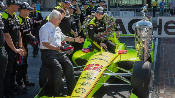 Simon Pagenaud, winner of the 103rd Indianapolis 500, talks with Roger Penske during the winner's photo shoot on the yard of brick at Indianapolis Motor Speedway on Monday, May 27, 2019.